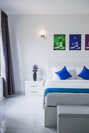 minimalist bedroom with pop of colour